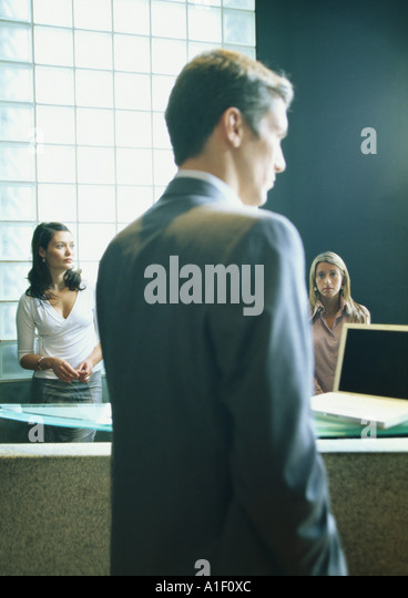 Man and two women in office - Stock Image