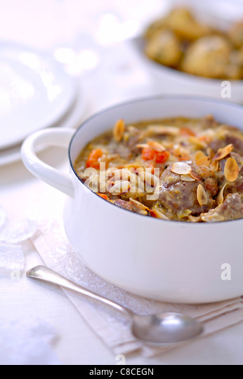 Beef stew with coconut milk and sliced almonds - Stock Image