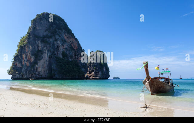 Wooden boat on the tropical beach Railay in Thailand. - Stock Image