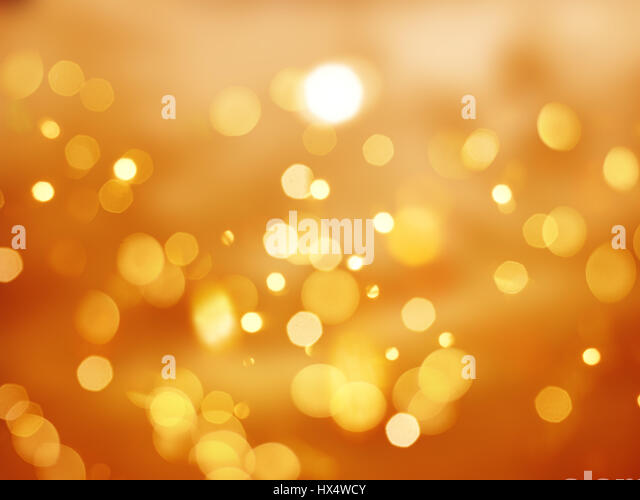 Orange background with bokeh lights - ideal for Halloween - Stock Image