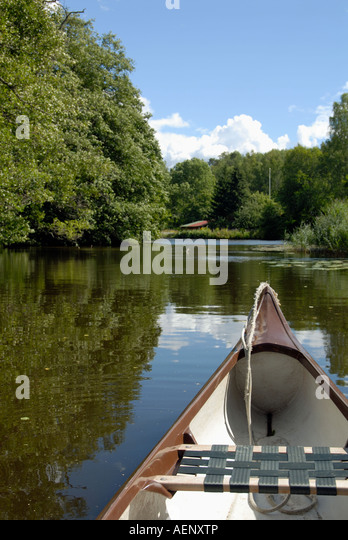 A quiet ride with the canoe in a stream in Sweden - Stock Image