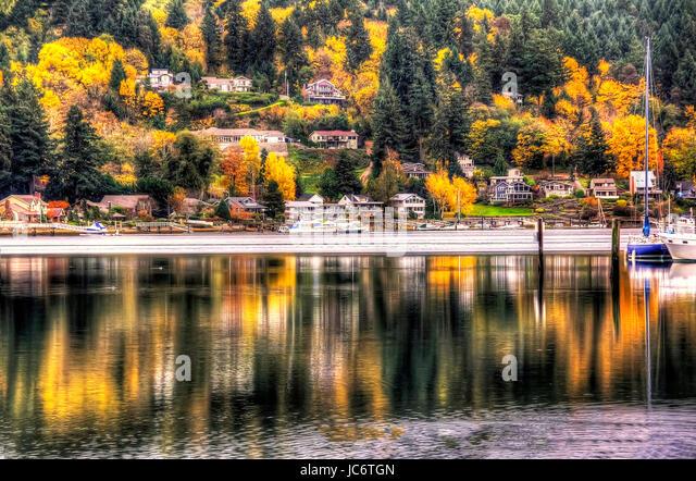 Autumn reflections  in Gig Harbor, Washington. - Stock Image