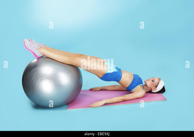 Abdominal Exercise. Sporty Woman with Fitness Ball - Stock Image