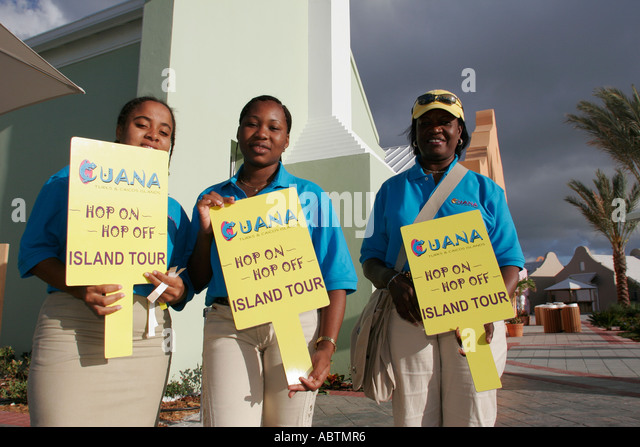 Grand Turk Cockburn Town Cruise Center Black male female tour guides signs - Stock Image