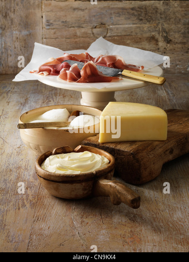Italian cheeses and parma ham on board - Stock Image