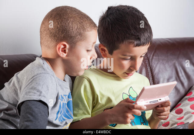 Boys playing computer game - Stock Image