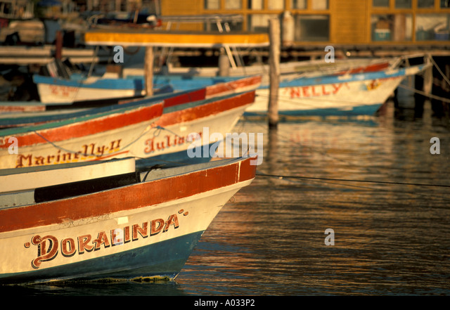mexico colorful fishing boats marina isla mujeres day trip excursion near cancun late afternoon - Stock Image