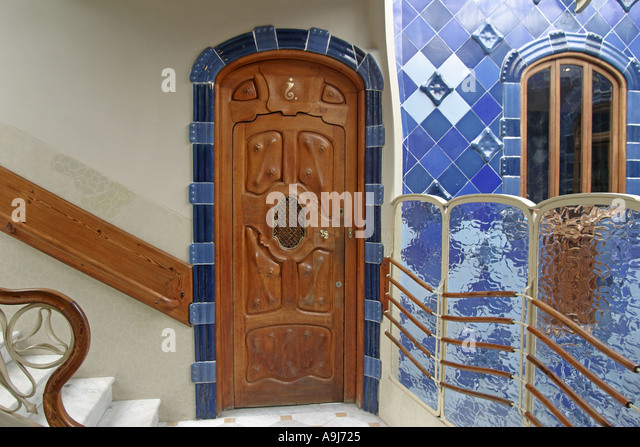 Barcelona Casa Batllo stairway with luxery door and blue tile  - Stock Image