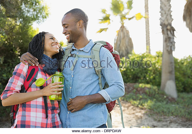 Affectionate couple taking a break from hiking - Stock-Bilder