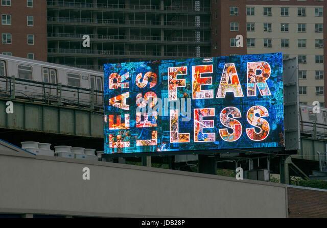 FEAR LESS. Mysterious digital billboard sign on Surf avenue in Coney Island, Brooklyn, New York - Stock Image