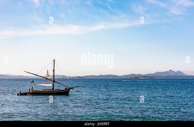 Fishing boat off the coast of Sardinia, Italy - Stock Image