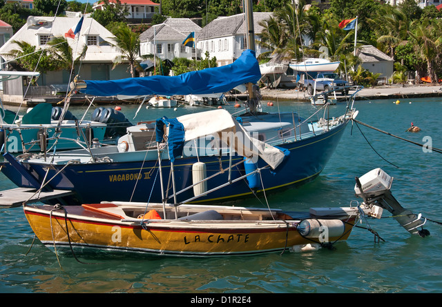 Closeup small sailboat and outboard motor boat Gustavia Harbor, Saint Barthelemy - Stock Image