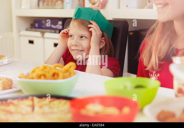 Children wearing paper crowns at christmas - Stock Image