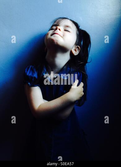 3-year old girl wearing denim dress - Stock Image