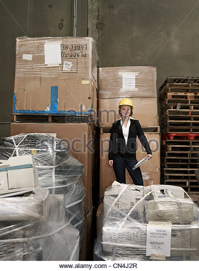 Woman in recycling warehouse - Stock Image
