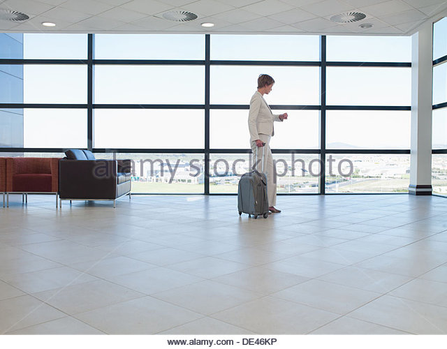 Businesswoman standing  waiting area in office - Stock Image