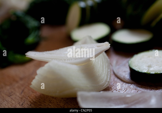 Freshly sliced onion and courgette - Stock Image