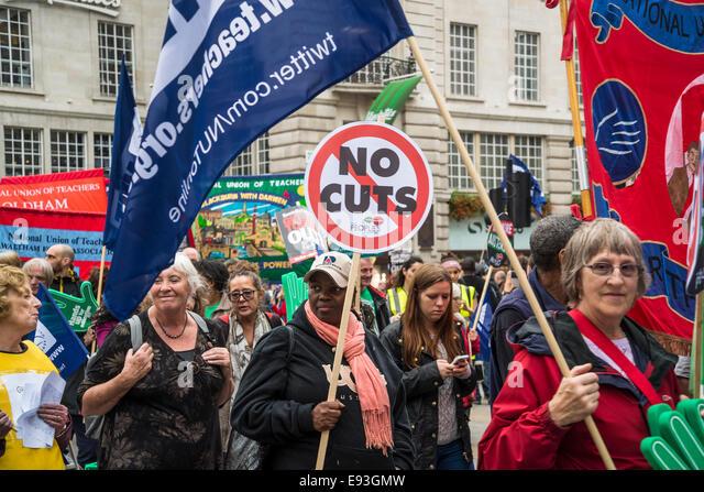 Woman with No Cuts placard. Britain Needs a Pay Rise march, London, 18 October 2014, UK Credit:  Bjanka Kadic/Alamy - Stock Image