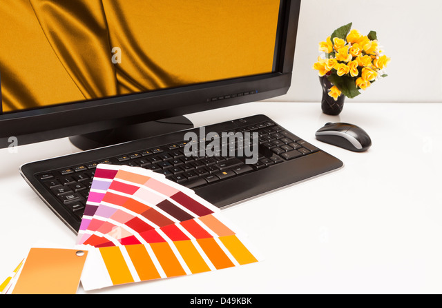Graphic designer at work. Color samples. Brown, yellow images - Stock Image