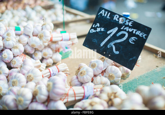 High Angle View Of Garlic On Sale At Store - Stock Image