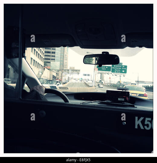 USA, New York State, New York City, Manhattan, Street scene from inside cab - Stock Image