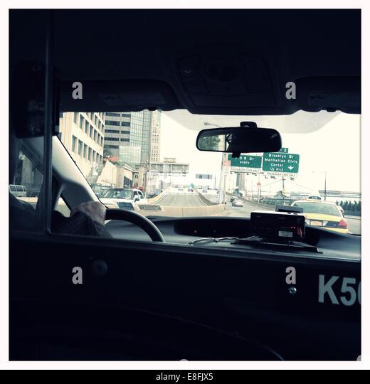 USA, New York State, New York City, Manhattan, Street scene from inside cab - Stock Image