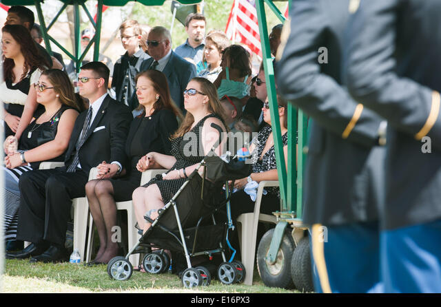Tucson, Arizona, USA. 24th May, 2014. MELINDA BARRERAS (ed. note: without sunglasses), the wife of Command Sgt. - Stock Image