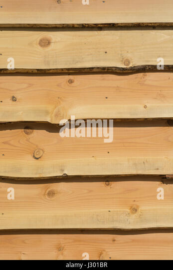 Wooden shingle wall (actually an outside office). - Stock Image