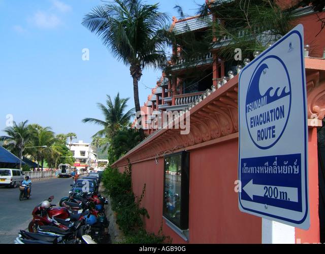 Thailand Phuket Tsunami warning evacuation road sign - Stock Image
