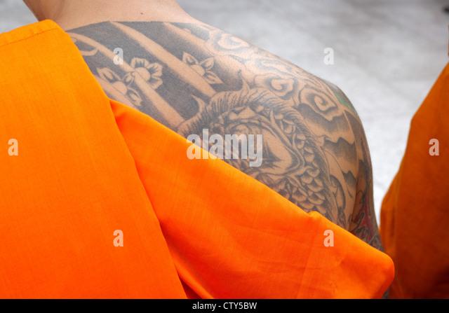 A Thai Buddhist Monk with tattoo on upper back - Stock-Bilder