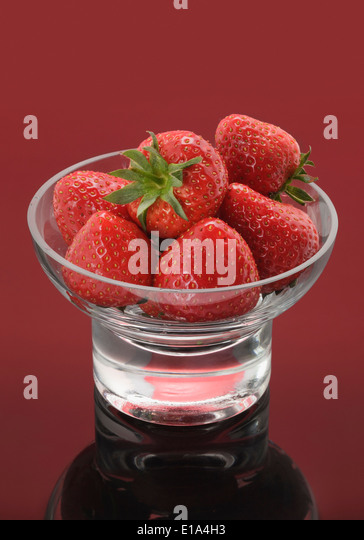 Glass Bowl with fresh Strawberries - Stock Image