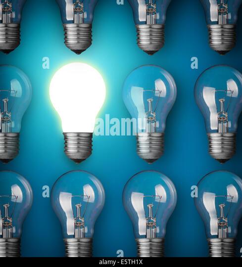 Idea concept with light bulbs on blue background - Stock-Bilder