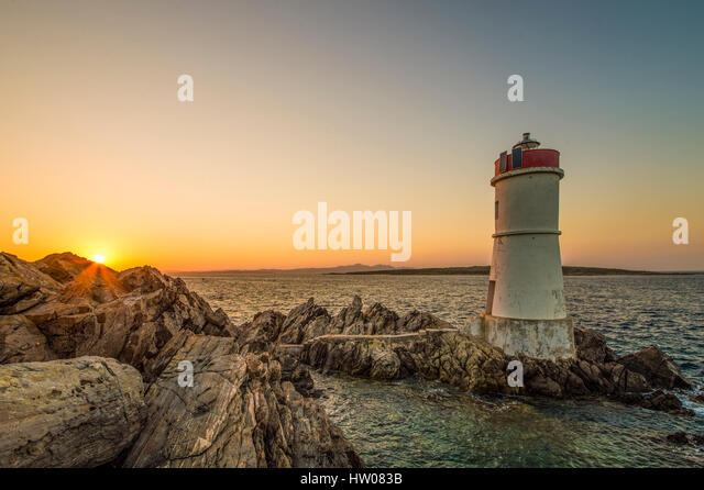 Lighthouse at sunset in Sardinia-Italy - Stock Image