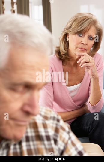 Senior Woman Caring For Sick Husband - Stock Image