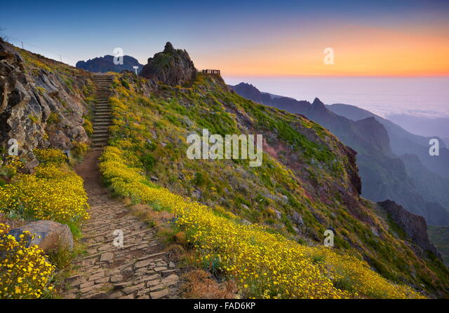 Mountain hiking trail from Pico do Arieiro to Pico Ruivo before sunrise, Madeira Island, Portugal - Stock Image
