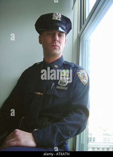 Portrait of a New York City Police Officer Near a Window - Stock Image
