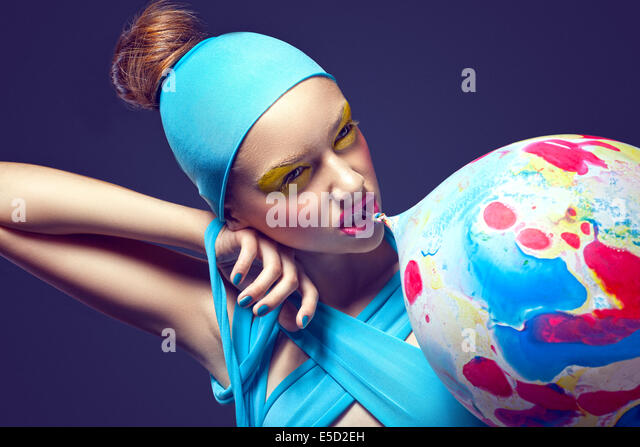 Grotesque. Eccentric Woman with Fancy Stagy Makeup and Air Balloon - Stock Image