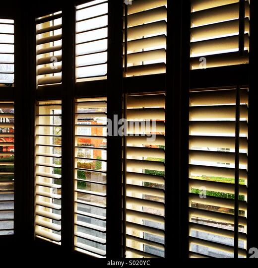 Open window shutters at an angle. - Stock Image