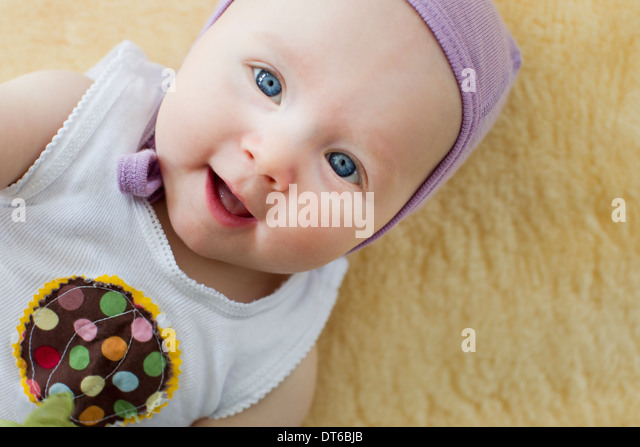Portrait of baby girl with blue eyes - Stock Image