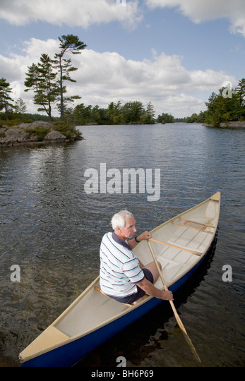 man in canoe - Stock Image