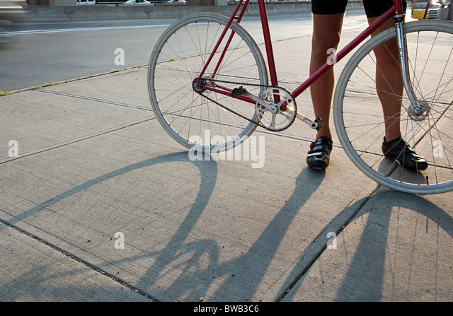 Cyclist with bike - Stock Image