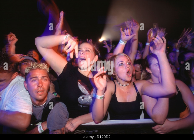 Young fans crowded in the front row during a free rock concert sponsored by Napster at a California University. - Stock Image