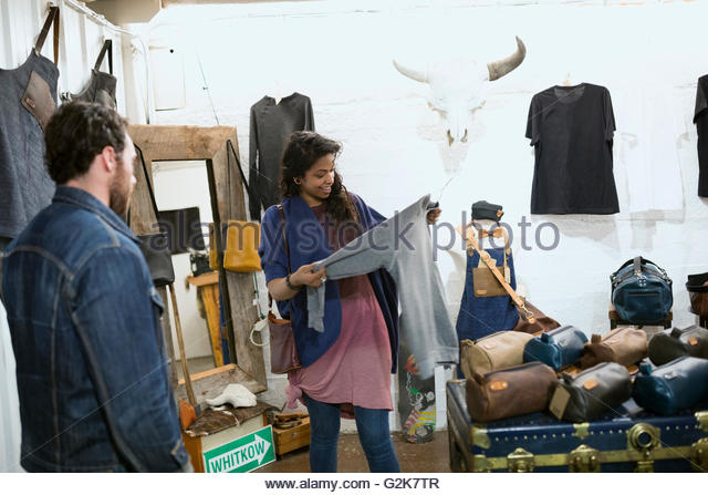 Couple shopping in leather shop - Stock Image