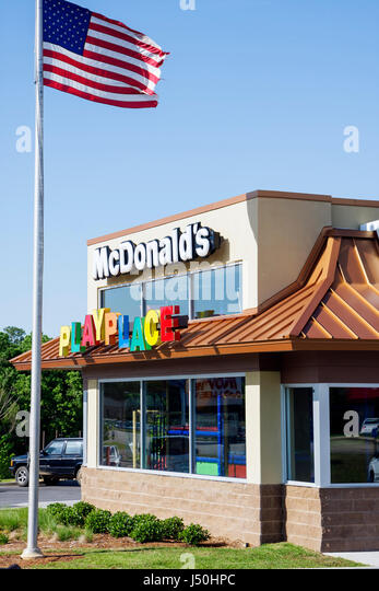 Monroeville Alabama McDonald's chain global corporation restaurant dining fast food name brand flag children - Stock Image