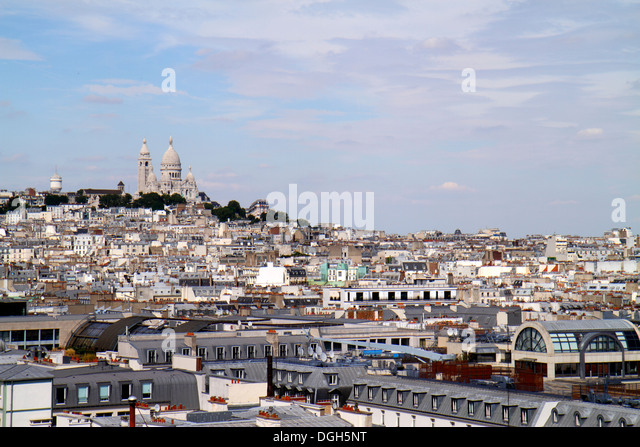 Paris France Europe French Sacré-Coeur Montmatre Rochechouart aerial rooftops city skyline Galeries Lafayette - Stock Image