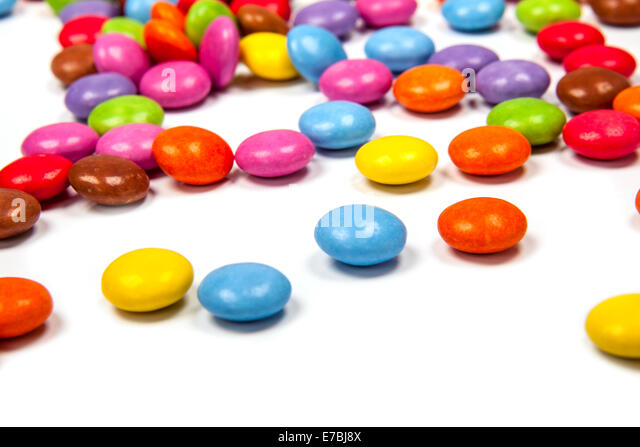 Close up of a pile of colorful chocolate coated candy - Stock Image