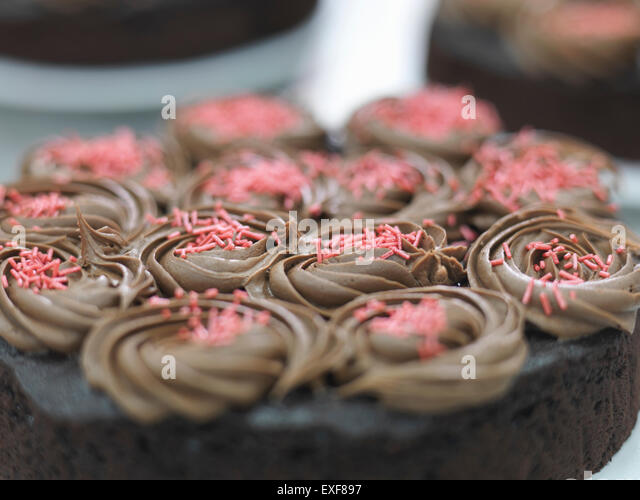 Prepared cake in cake factory, close up - Stock Image