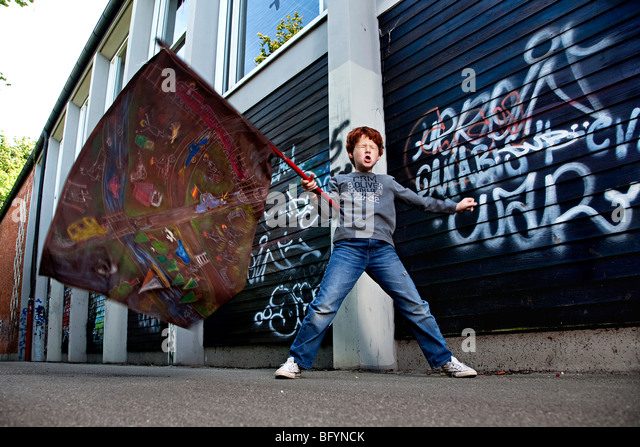 young boy with flag - Stock Image