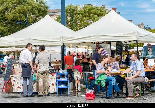 France Gironde Bordeaux Chartrons Sunday market where they sell all Bordeaux specialties stand with onsite catering - Stock Image