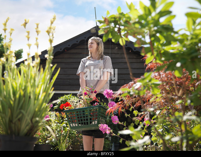 Female Buying Plants At Garden Center - Stock Image